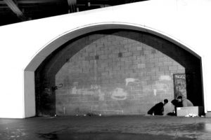 "Homeless people take shelter under Waterloo Bridge in Central London.By <a href=""http://www.cgpgrey.com"">GBP Grey </a> [<a href=""http://creativecommons.org/licenses/by/2.0"">CC BY 2.0</a>], via <a href=""https://commons.wikimedia.org/wiki/File%3AHomeless_in_Waterloo_(4888527878).jpg"">Wikimedia Commons"